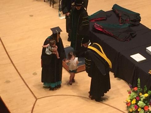 ari taking diploma